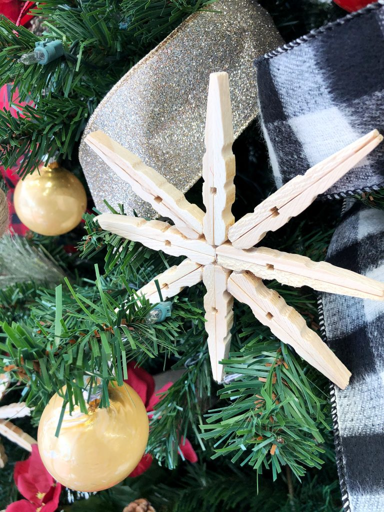 Clothespin snowflakes on the tree.