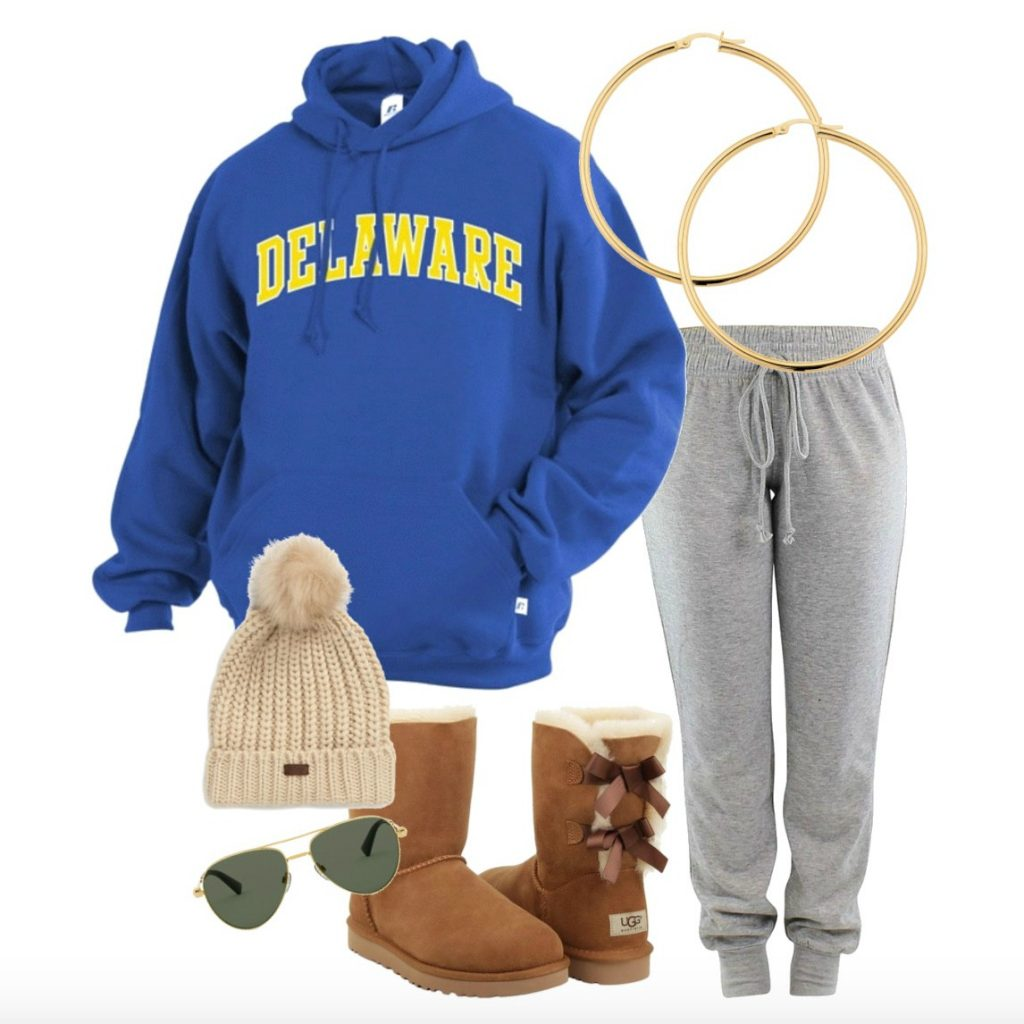 Cozy look featuring royal blue Arched Delaware hoodie & grey sweatpants with tan and gold winter accessories.