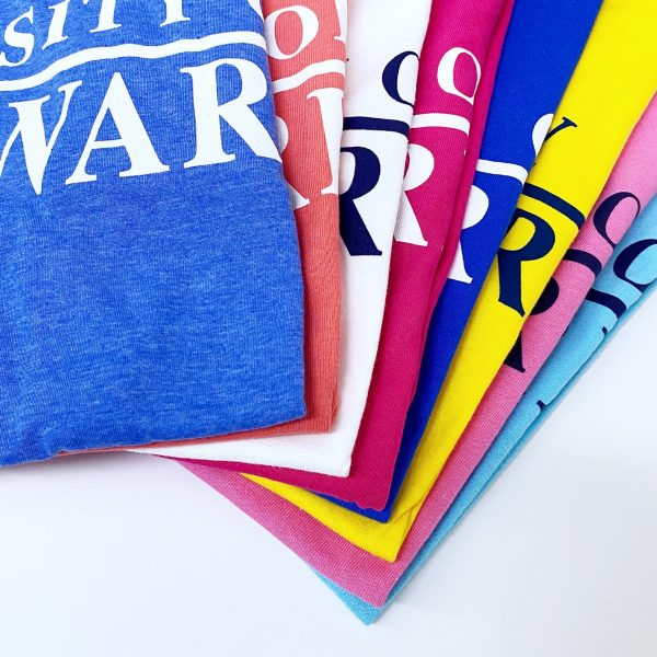 Detail of University of Delaware Skittles Short Sleeve T-shirts in 8 Bright Colors