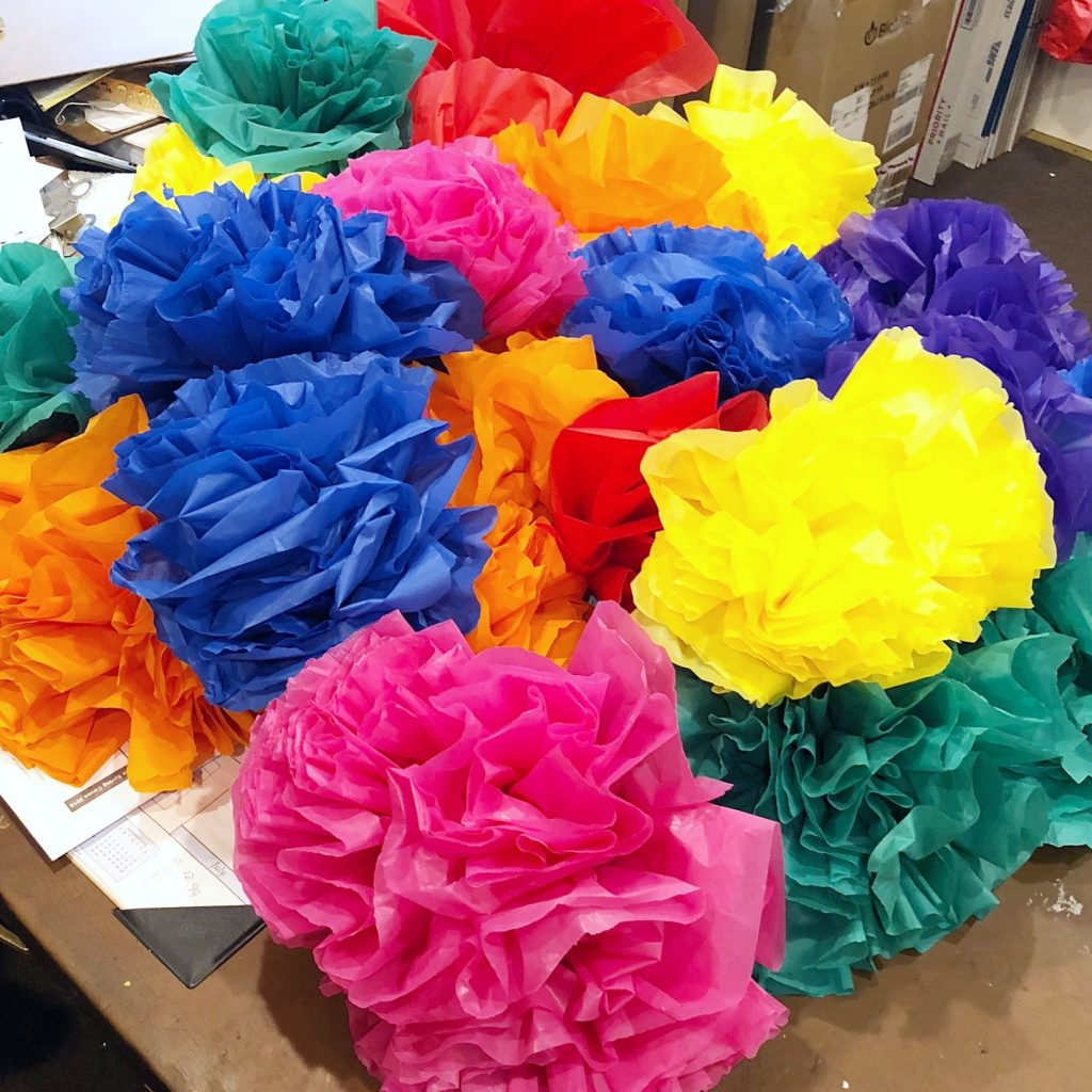 Colorful pom-pom flowers made form recycled plastic tablecloths.