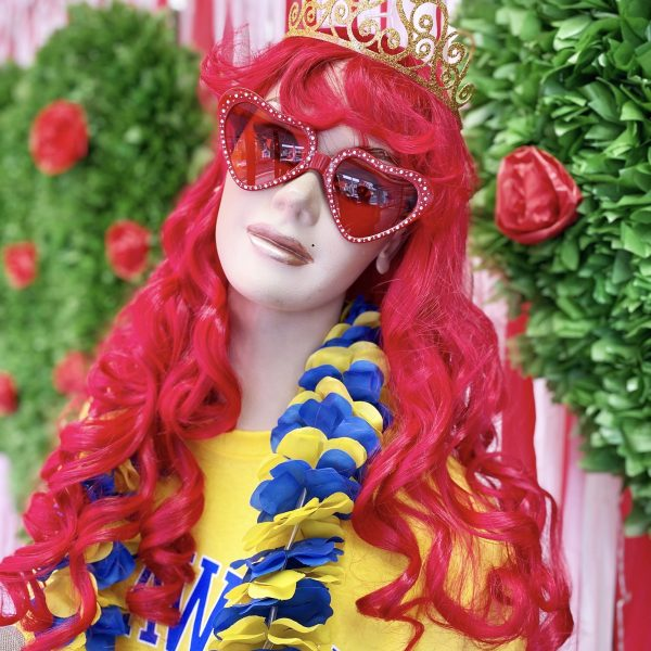 Long curly red mermaid wig shown on mannequin
