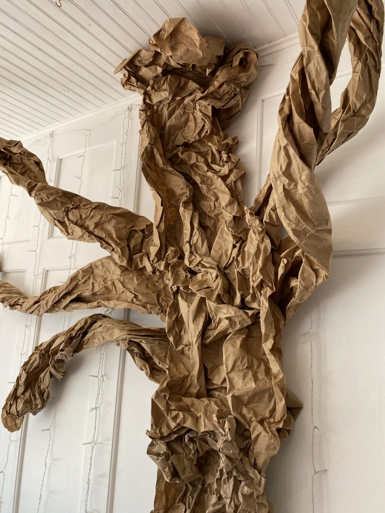 Recycled paper tree made from brown packing paper.