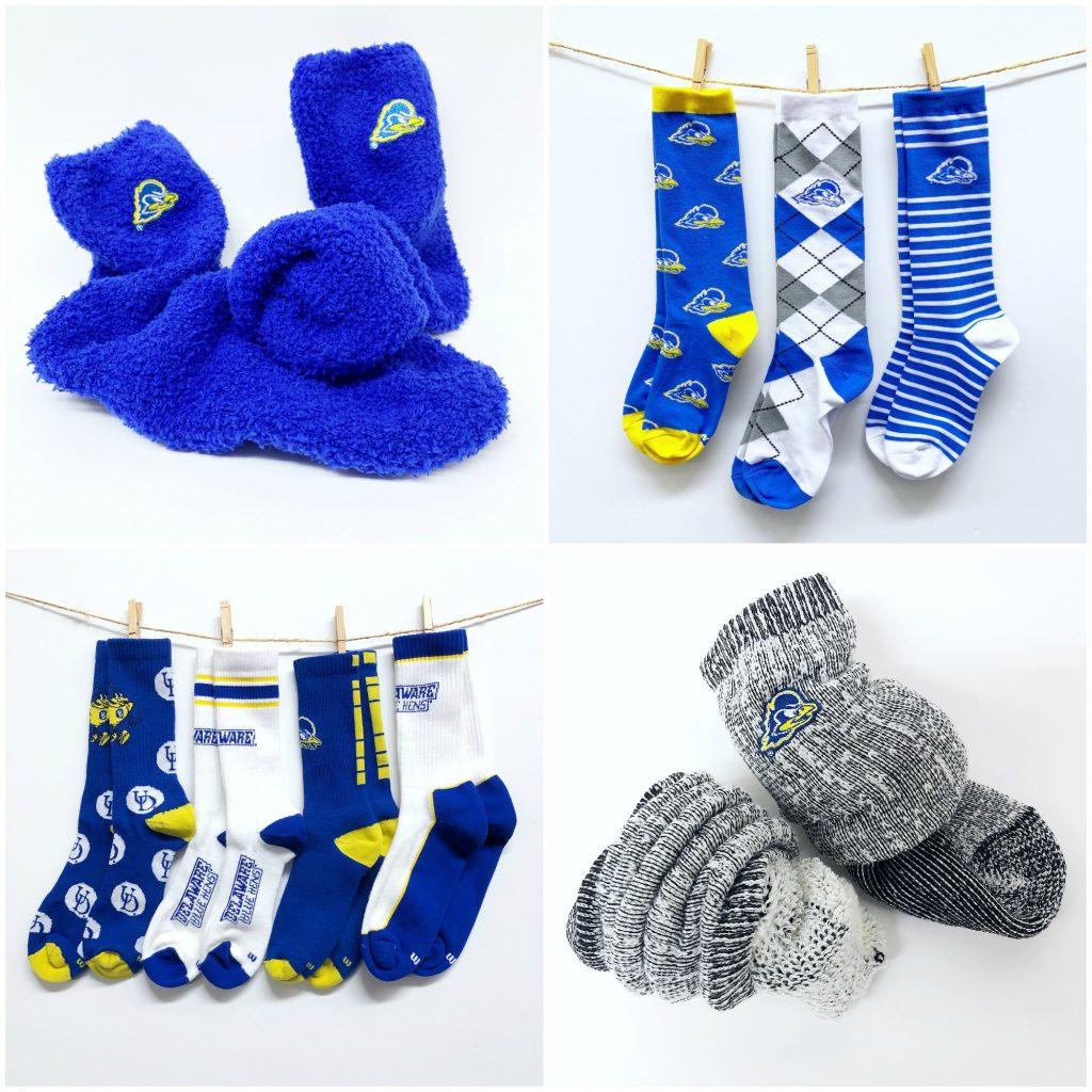 Assortment of University of Delaware socks including cuddle socks, athletic socks, hiking socks and fashion socks.
