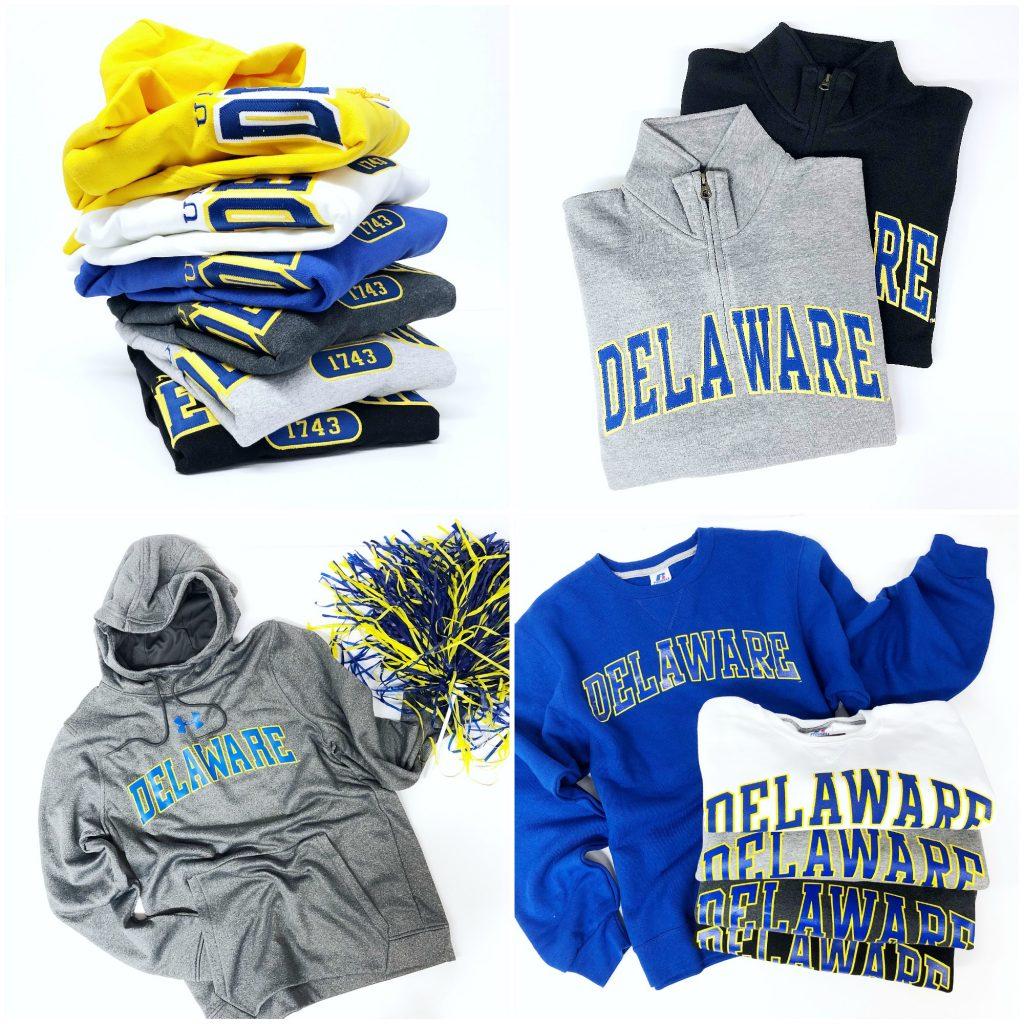 Assortment of University of Delaware sweatshirts including crew neck, hoodie and quarter-zip styles.